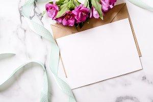 Flat lay marble desk invitation card