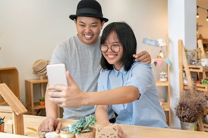 Asian Young Couple taking the selfie