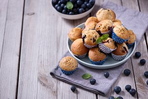 Blueberry muffins on wooden table