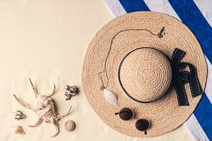 Straw hat with sunglasses and seashe