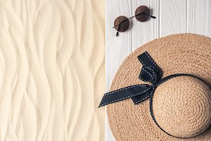 Straw hat and sunglasses on light sa