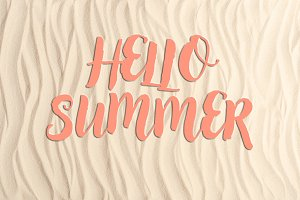 Hello summer inscription on sandy be
