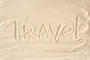 Travel inscription on summer sandy b