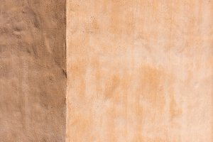 empty light brown concrete wall text