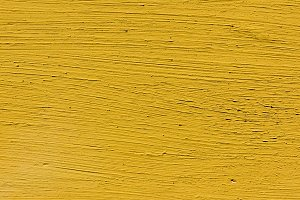 close-up view of yellow scratched co