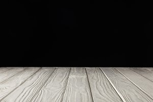 white grungy wooden table on black