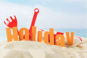 Beach toys and Holiday inscription i
