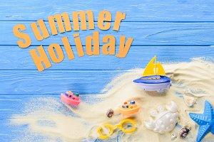 Beach toys by Summer holiday inscrip