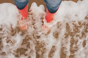 Woman weared red rubber Boots on the