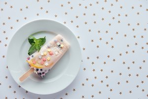top view of delicious fruity popsicl
