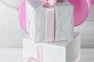 Stacked present boxes and bright bal