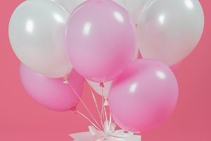Presents with white and pink balloon
