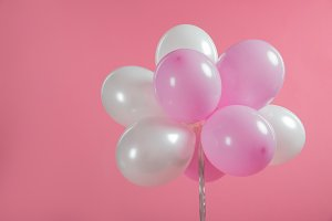 Pink and white party balloons isolat