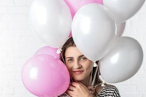 Smiling woman holding pink and white