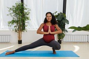 Pregnant woman doing yoga pose