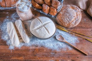 Bread and flour on a rustic wooden t