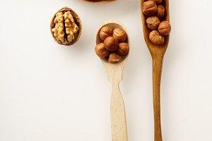 Walnuts and hazelnuts in wooden spoo