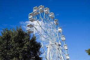 White ferris wheel against the blue