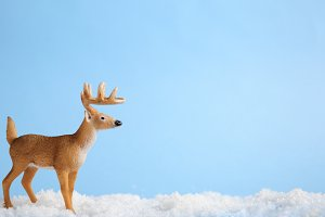 Toy horned deer on artificial snow