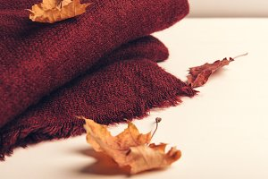 Folded burgundy knitted scarf