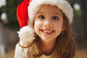 little beautiful girl with red santa
