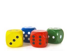Four colorful gaming dices in a row