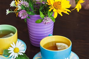 Cups of herbal tea with camomile, le