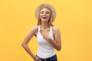 Laughing young beautiful woman in t