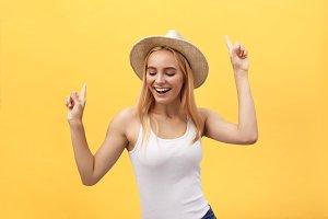 Young beautiful woman dancing in
