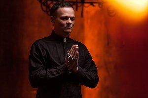 Young Catholic Praying priest. Portr