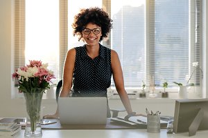 Happy businesswoman standing