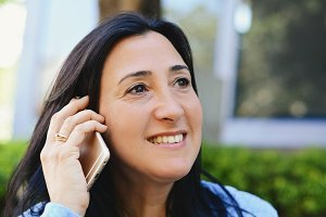 Middle aged woman talking on phone