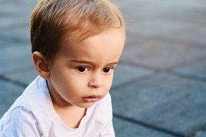 Portrait of baby boy on the street