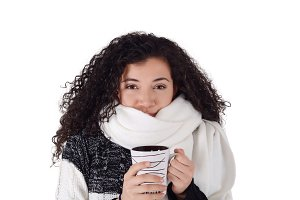 Winter girl drinking coffee to warm