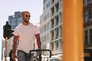 Handsome man enjoying city walk