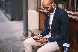 Happy businessman listening music
