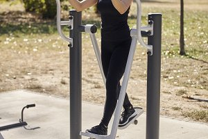 one young woman, outdoors public gym