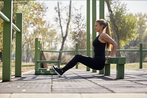 one young woman, outdoors gym in pub
