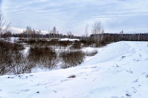 snow covered hills by the river