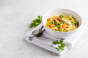 Chicken noodle soup and vegetables