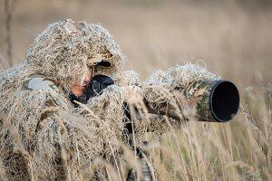 Wildlife photographer in the ghillie
