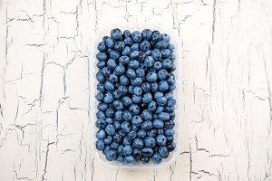 Fresh blueberries on light table