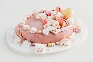 close up of pink cake with marshmall