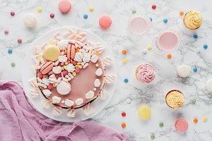 top view of pink birthday cake with