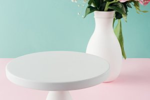 empty white cake stand and bouquet o