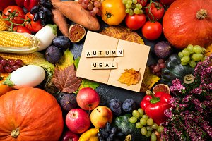 Autumn fruits vegetables and leaves