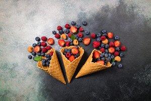 Fresh berries in ice cream cone