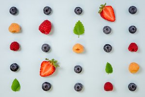 Pattern of berries on blue