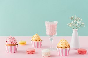 cupcakes and sweet macarons and glas