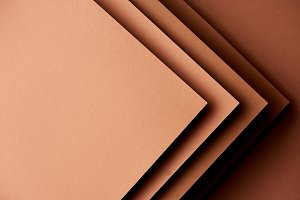Paper sheets in brown tones backgrou
